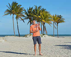 April 1, 2018 - Miami, FL, United States - KEY BISCAYNE, FL - APRIL 01: John Isner (USA) heads to the Crandon State Park Beach for pictures with the Championship Trophy after defeating Alexander Zverev (GER) 67(4) 64 64 at the 2018 Miami Open held at the Tennis Center at Crandon Park on April 1, 2018.   Credit: Andrew Patron/Zuma Wire (Credit Image: © Andrew Patron via ZUMA Wire)