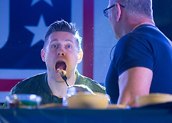 """December 21, 2017 - Sevilla, Spain - Chef Robert Irvine feeds WWE Superstar """"The Miz"""" as part of a cooking demonstration during the Chairmans USO Holiday Tour at Moon Air Base Dec. 21, 2017. .(Credit Image:"""