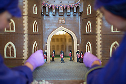 Chocolatiers pipe the finishing touches onto the front of Windsor Castle at Cadbury World in Birmingham, which is made entirely out of chocolate and includes the Henry VIII gate with a hand-piped picture of St George's Chapel visible through it, ahead of the royal wedding this weekend.
