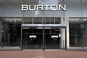 As the third national coronavirus lockdown continues, high street menswear clothing brand Burton is closed down on 24th March 2021 in Birmingham, United Kingdom. In 2020, Arcadia, the owners of Burton, went into administration, putting the brand up for sale; in February 2021, Boohoo.com acquired the brand from its administrators. Following the recent surge in cases including the new variant of Covid-19, this nationwide lockdown, which is an effective Tier Five, came into operation yesterday, with all citizens to follow the message to stay at home, protect the NHS and save lives.