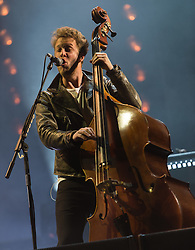 © Licensed to London News Pictures. 28/08/2015. Reading Festival, UK.  Mumford and Sons performing at Reading Festival 2015 28 August 2015 Day 1.  In this picture - Ted Dwane.  Photo credit: Richard Isaac/LNP