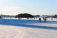Norway, Stavanger. Ice-skating on Store Stokkavatn, close to the center of Stavanger.