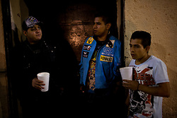 A group of young men stand on the streets of Tepito, one of the most notorious neighborhoods in Mexico City.  They drink beer and smoke pot freely on the streets with no fear that the police will catch them.