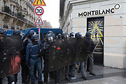 December, 8th, 2018 - Paris, Ile-de-France, France: Riot police on Champs Elysees near Montblanc shop. The French 'Gilets Jaunes' demonstrate a fourth day. Their movement was born against French President Macron's high fuel increases. They have been joined en mass by students and trade unionists unhappy with Macron's policies. Nigel Dickinson