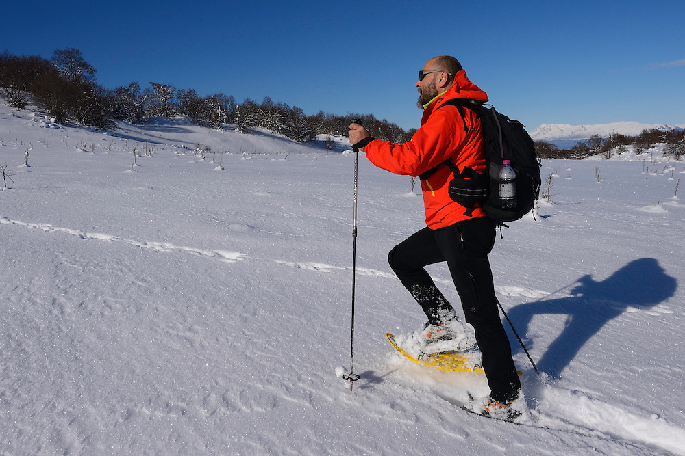 Snowshoeing, mountain guide and lodge owner Carlo Vitale, Rewilding Europe, Central Apennines, Italy