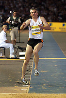 Photograph: Scott Heavey<br />IAAf Super Grand Prix. Norwich Union London Athletics meeting from Crystal Palace. 08/08/2003.<br />Jonathan Edwards goes over on his ankle.