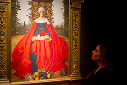 © Licensed to London News Pictures. 08/12/2011. London, UK. Frank Cadogan Cowper's 'Our Lady of the Fruits of the Earth'- The original painting of the famous Christmas card design (est £150,000-£250,000) on display at Christie's where it will be auctioned off on 15th December, the auction is expected to realise in excess of £4.5million.  Photo credit : James Gourley/LNP