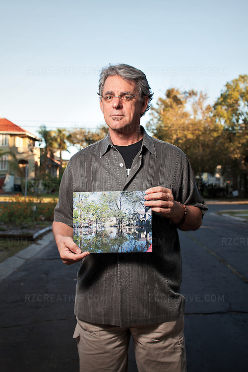 New Orleans resident John Hazlett holds a photo he shot from the seat of his kayak showing his street the day after Hurricane Katrina.