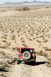 October 17, 2018 - Johnson Valley, California, U.S. - A vehicle on the course on Day 5 of the third annual Rebelle Rally, the first women's off-road navigation rally in the United States. The event features a unique scoring system in which precise navigation - not speed - is the ultimate goal.  With cell phones and GPS devices banned during the 10-day event, and armed with just maps, compasses and roadbooks, 43 two-person teams are tasked with scoring points based on time, distance and hidden checkpoints as they make their way across 1,600 miles of scrub brush, sand dunes and boulders in the Nevada and California desert.(Credit Image: © Brian Cahn/ZUMA Wire)