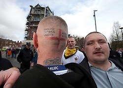 "© under license to London News Pictures. 02/04/2011: An EDL supporter shows his English Defence League Nottingham Division tattoo ahead of a rally in Blackburn. About 2000 EDL supporters were in attendance. It was one of the largest policing operations Lancashire police have ever put in to action. Credit should read ""Joel Goodman/London News Pictures""."