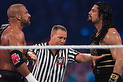 Roman Reigns and Triple H prepare to fight during WrestleMania on April 3, 2016 in Arlington, Texas.