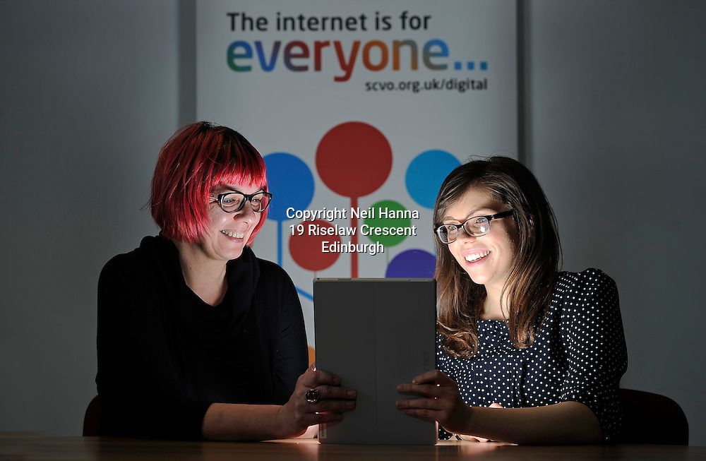 Hundreds of new digital champions will help vulnerable people in Scotland get onlineThe Scottish Council for Voluntary Organisation (SCVO) has received investment of £528,219 from the Big Lottery Fund to help more people connect with the online world by training hundreds of people in charities across Scotland as digital champions. <br /> <br /> OneDigital, which has been developed by SCVO along with digital skills provider Digital Unite, and Citizens Online, Age UK, Ability Net and Affinity Sutton was launched today, 11th Feb by Fiona Hyslop MSP, Secretary for Culture, Europe and External Affairs on a visit to the Edinburgh Voluntary Organisations' Council (EVOC)<br /> <br /> Pic caption:<br /> Sally Dyson, Head of Digital Participation at SCVO helps Sarah Wardrop with her digital  skills.<br /> <br />  Neil Hanna Photography<br /> www.neilhannaphotography.co.uk<br /> 07702 246823