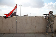 National Guard looking for snipers on top of an Iraqi Police station in Sadr City
