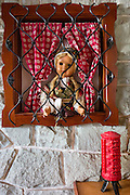 Caged doll in window, Mojstrana, Slovenia, Europe. In 1991, Slovenia declared full sovereignty from Yugoslavia. 80% of its 2 million people speak Slovene. In 2004, Slovenia joined NATO and the EU (European Union), and later adopted the Euro € currency. Slovenia is the richest Slavic nation per capita.