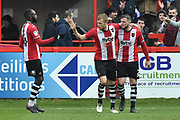 Goal - Pierce Sweeney (2) of Exeter City celebrates scoring a goal from the penalty spot to give a 2-1 lead to the home team with Jayden Stockley (11) of Exeter City and Hiram Boateng (44) of Exeter City during the EFL Sky Bet League 2 match between Exeter City and Swindon Town at St James' Park, Exeter, England on 24 March 2018. Picture by Graham Hunt.