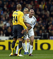Photo: Chris Ratcliffe.<br />Real Madrid v Arsenal. UEFA Champions League. 2nd Round, 1st Leg. 21/02/2006.<br />French Connection, Zinedine Zidane of Real Madrid patsThierry Henry of Arsenal on the backside.