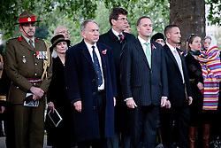 © licensed to London News Pictures. ANZAC MEMORIAL, LONDON, UK  25/04/11. New Zealand Prime Minister, John Key (Pin Stripe Suit), waits with a delegation before laying a wreath at the New Zealand War Memorial at Hyde Park Corner. Thousands gathered at a dawn service at the Australian and New Zealand War Memorials in London today to remember the fallen soldiers of those countries as part of Anzac Day. Please see special instructions for usage rates. Photo credit should read Matt Cetti-Roberts/LNP