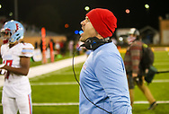 AC Flora Falcons head coach Dustin Curtis directs his team against the North Myrtle Beach Chiefs during the first half the state championship game at Benedict College.