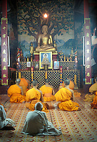 monks in a temple  in Luang Prabang, Laos, a UNESCO World Heritage Center.