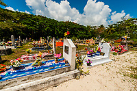 Graves in cemetery, Luengoni, Lifou (island), Loyalty Islands, New Caledonia