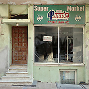 A closed down supermarket in 1878 Str, Heraklion , Crete