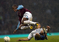 Photo: Olly Greenwood.<br />West Ham United v Brighton & Hove Albion. The FA Cup. 06/01/2007. West Ham's Luis Boa Morte tackled by  Brighton's Adam El-Abd