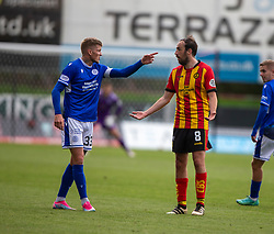 31JUL21 Queen of the South's Willie Gibson and Partick Thistle's Kyle Turner. Partick Thistle 3 v 2 Queen of the South. First Scottish Championship game of the season.