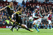 Chelsea's John Terry and Cesar Azpilicueta try to block a shot from Aston Villa's Fabian Delph (16). Barclays Premier League, Aston Villa v Chelsea at Villa Park in Birmingham on Saturday 11th May 2013. pic by Andrew Orchard,  Andrew Orchard sports photography,