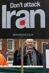 © licensed to London News Pictures. London, UK 28/01/12. Tony Benn speaks as Stop War Coalition protests against Western intervention in the Middle East, outside US Embassy in London. Photo credit: Tolga Akmen/LNP