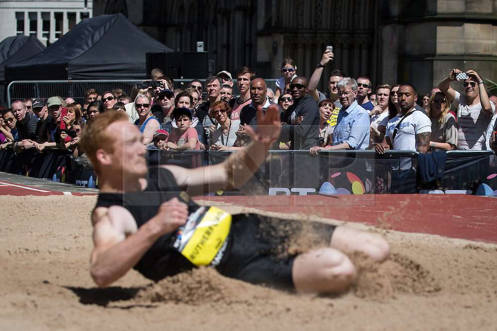 © Licensed to London News Pictures . 17/05/2014 . Manchester , UK . The crowd watch Greg Rutherford jump . The Great City Games in Manchester , with athletics on a track along Deansgate and Pole Vault and Long Jump in Albert Square . Photo credit : Joel Goodman/LNP