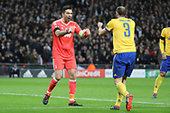 Juventus goalkeeper Gianluigi Buffon (1) and Juventus defender Giorgio Chiellini (3) about to bumnp fists during the Champions League match between Tottenham Hotspur and Juventus FC at Wembley Stadium, London, England on 7 March 2018. Picture by Matthew Redman.