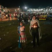 Offering light at a fair.