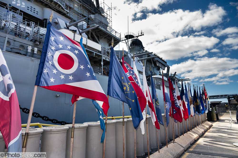 "State flags at USS Missouri museum dock, Pearl Harbor, Oahu, Hawaii, USA. Ordered in 1940 and active in June 1944, the USS Missouri (""Mighty Mo"") was the last battleship commissioned by the United States. She is best remembered as the site of the surrender of the Empire of Japan which ended World War II on September 2, 1945 in Tokyo Bay. In the Pacific Theater of World War II, she fought in the battles of Iwo Jima and Okinawa and shelled the Japanese home islands. She fought in the Korean War from 1950 to 1953. Decommissioned in 1955 into the United States Navy reserve fleets (the ""Mothball Fleet""), she was reactivated and modernized in 1984 and provided fire support during Operation Desert Storm in January-February 1991. The ship was decommissioned in March 1992. In 1998, she was donated to the USS Missouri Memorial Association and became a museum at Pearl Harbor, on the island of Oahu, Hawaii, USA."