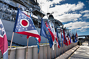 """State flags at USS Missouri museum dock, Pearl Harbor, Oahu, Hawaii, USA. Ordered in 1940 and active in June 1944, the USS Missouri (""""Mighty Mo"""") was the last battleship commissioned by the United States. She is best remembered as the site of the surrender of the Empire of Japan which ended World War II on September 2, 1945 in Tokyo Bay. In the Pacific Theater of World War II, she fought in the battles of Iwo Jima and Okinawa and shelled the Japanese home islands. She fought in the Korean War from 1950 to 1953. Decommissioned in 1955 into the United States Navy reserve fleets (the """"Mothball Fleet""""), she was reactivated and modernized in 1984 and provided fire support during Operation Desert Storm in January-February 1991. The ship was decommissioned in March 1992. In 1998, she was donated to the USS Missouri Memorial Association and became a museum at Pearl Harbor, on the island of Oahu, Hawaii, USA."""