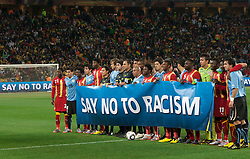Players of Uruguay and Ghana against racism during the 2010 FIFA World Cup South Africa Quarter Finals football match between Uruguay and Ghana on July 02, 2010 at Soccer City Stadium in Sowetto, suburb of Johannesburg. Uruguay defeated Ghana after penalty shots. (Photo by Vid Ponikvar / Sportida)