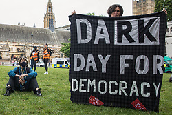 An activist holds a banner at a Kill The Bill protest in Parliament Square against the Police, Crime, Sentencing and Courts (PCSC) Bill 2021 as MPs consider amendments to the Bill in the House of Commons on 5th July 2021 in London, United Kingdom. The PCSC Bill would grant the police a range of new discretionary powers to shut down protests, including the ability to impose conditions on any protest deemed to be disruptive to the local community, wider stop and search powers and sentences of up to 10 years in prison for damaging memorials.