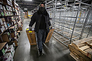 Eric Mesa pulls boxes of flowers stored in the cooler at Florida Beauty Flora, Inc. warehouse in Miami onThursday, April 9, 2020. South Florida is a major hub of the flower import transport business shipping across the nation. But since many places are closed, the demand for Easter flowers has declined by some 70%.