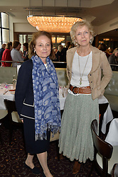 Left to right, CHRISSIE REID and TWINKS KER at a ladies lunch in aid of the charity Maggie's held at Le Cafe Anglais, 8 Porchester Gardens, London on 29th April 2014.