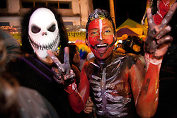 North America, Mexico, Oaxaca Province, Oaxaca, teenagers in costumes during Day of the Dead (Dias de los Muertos) procession at night