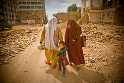 People walk through demolition site in Old City, Xinjiang, China.