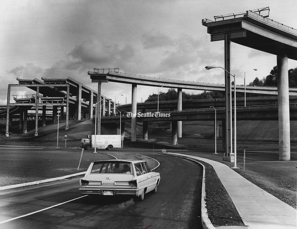 """A few loose ends of the freeway stood on their supporting structures waiting to be """"plugged into"""" future construction. The I-90 interchange stubs, as seen from South Connecticut Street and Airport Way South, seemed to grope in space without purpose. (Ron DeRosa / The Seattle Times, 1966)"""