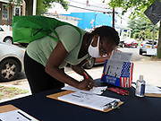 At a DC Board of Election registration site, one woman signs up to become a poll worker.