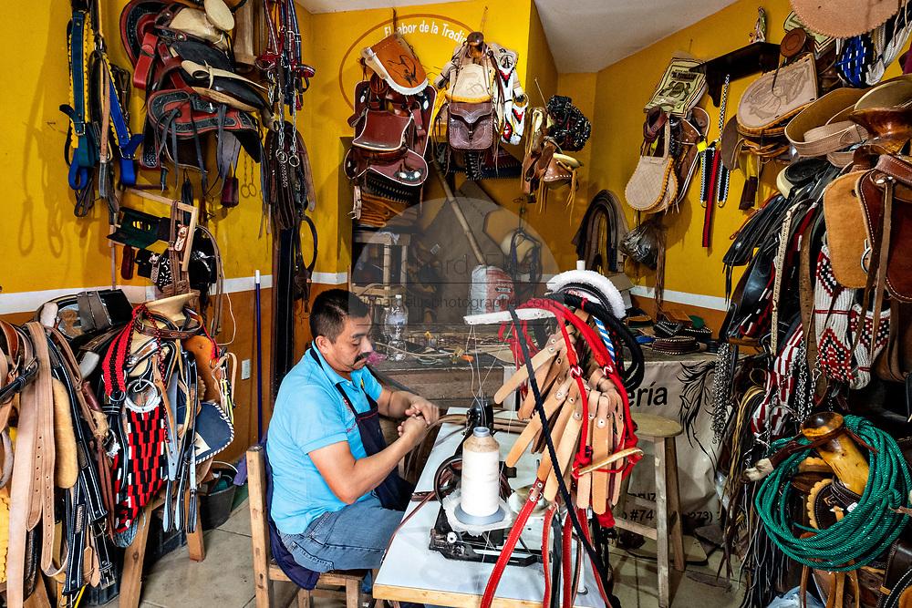 A saddler handcrafts saddles at his leather shop in Santiago Tuxtla, Veracruz, Mexico.