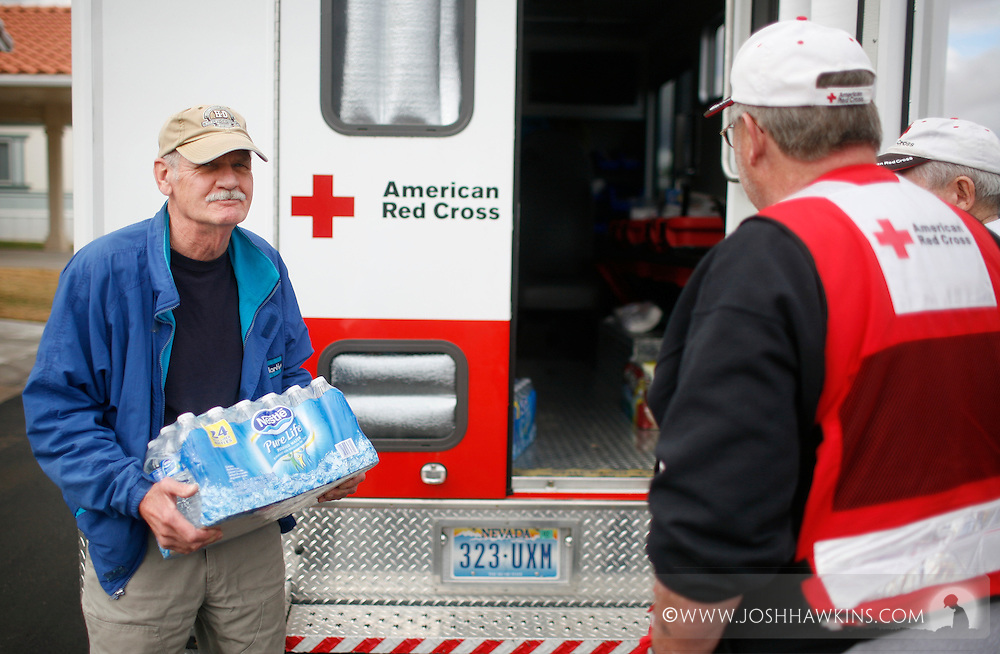 Red Cross disaster assessment teams in Beaver Dam, AZ on December 23rd, 2010 after the flooding the occurred over the previous days...Tom Delux gets water from the Red Cross Emergency Response Vehicle.  Tom is visiting his mother who leaves in Beaver Dam and there are four disabled people in the home he was getting water for.  (Tom is also a former Red Cross volunteer.)
