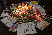 A small shrine is constructed as people gather in silent vigil to honour hostages, Kenji Goto and Haruna Yukawa, who were murdered by ISIS terrorists in Syria in January. Shibuya, Tokyo, Japan Sunday February 8h 2015. Over 100 people gathered in Shibuya's famous Hachiko square at 5pm to hold a silent prayer vigil for the Japanese hostages and Jordan pilot. The vigil ended at 7:30pm with a small candle-lit shrine. Friends of the hostages were in the vigil and promised that all flowers and messages would be delivered to relatives.