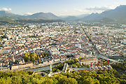 Grenoble city and cable car seen from Bastille with mountains on horizon Grenoble, France