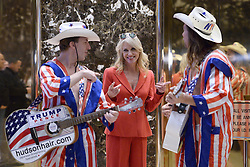 """Kellyanne Conway, campaign manager and strategist, is seen in the lobby of the Trump Tower with the """"Naked Cowboy"""" themed performers in New York, NY, on November 28, 2016. (Anthony Behar / Pool)"""
