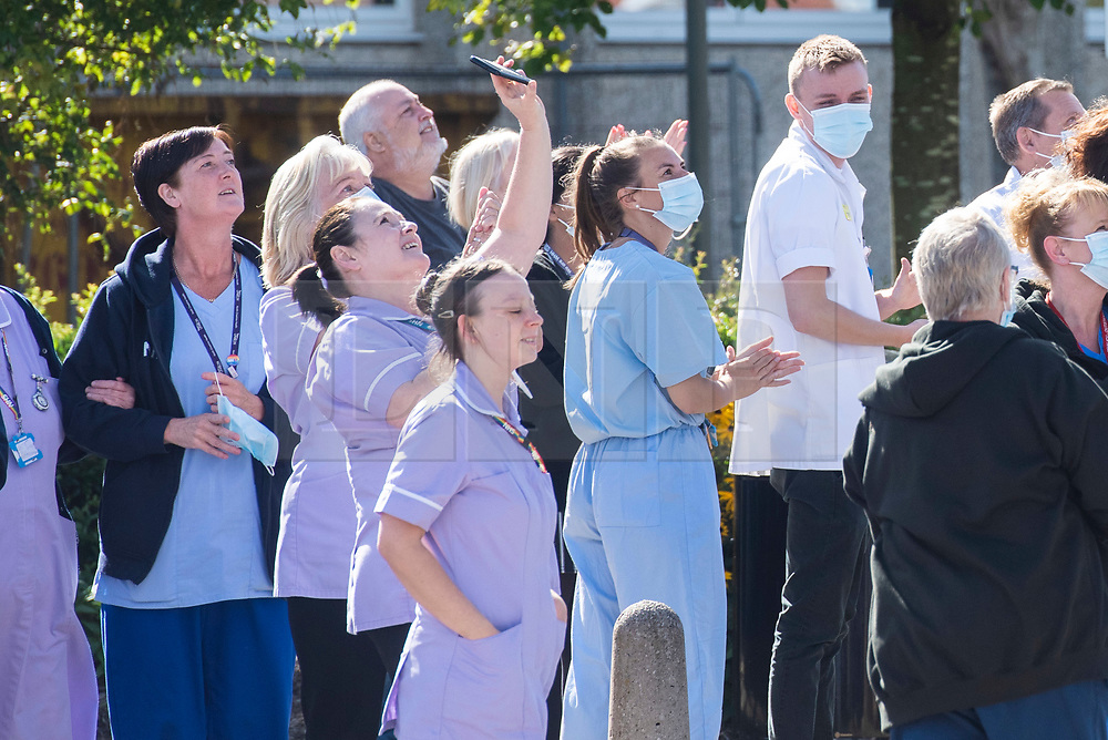 © Licensed to London News Pictures. 30/08/2020. Warrington, UK. NHS staff and members fo the public enjoy the Spitfire fly over at Warrington and Halton Hospital. Photo credit: Kerry Elsworth/LNP