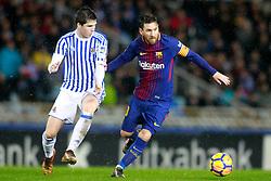 Real Sociedad's Igor Zubeldia (l) and FC Barcelona's Leo Messi during La Liga Real Sociedad v FC Barcelona match in San Sebastian-Donostia, Spain, January 14, 2018. Photo by Acero/AlterPhotos/ABACAPRESS.COM