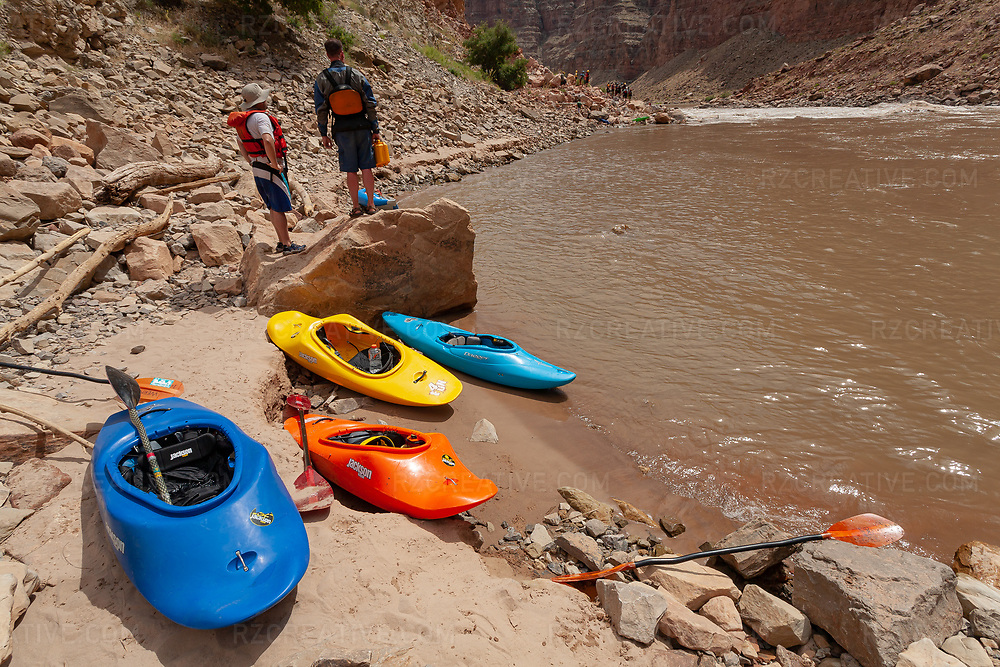 A group of paddlers scout a large rapid in Cataract Canyon —a 46 mile long canyon of the Colorado River located within Canyonlands National Park and Glen Canyon National Recreation Area in southern Utah. Photo © Robert Zaleski / rzcreative.com<br /> —<br /> To license this image for editorial or commercial use, please contact Robert@rzcreative.com